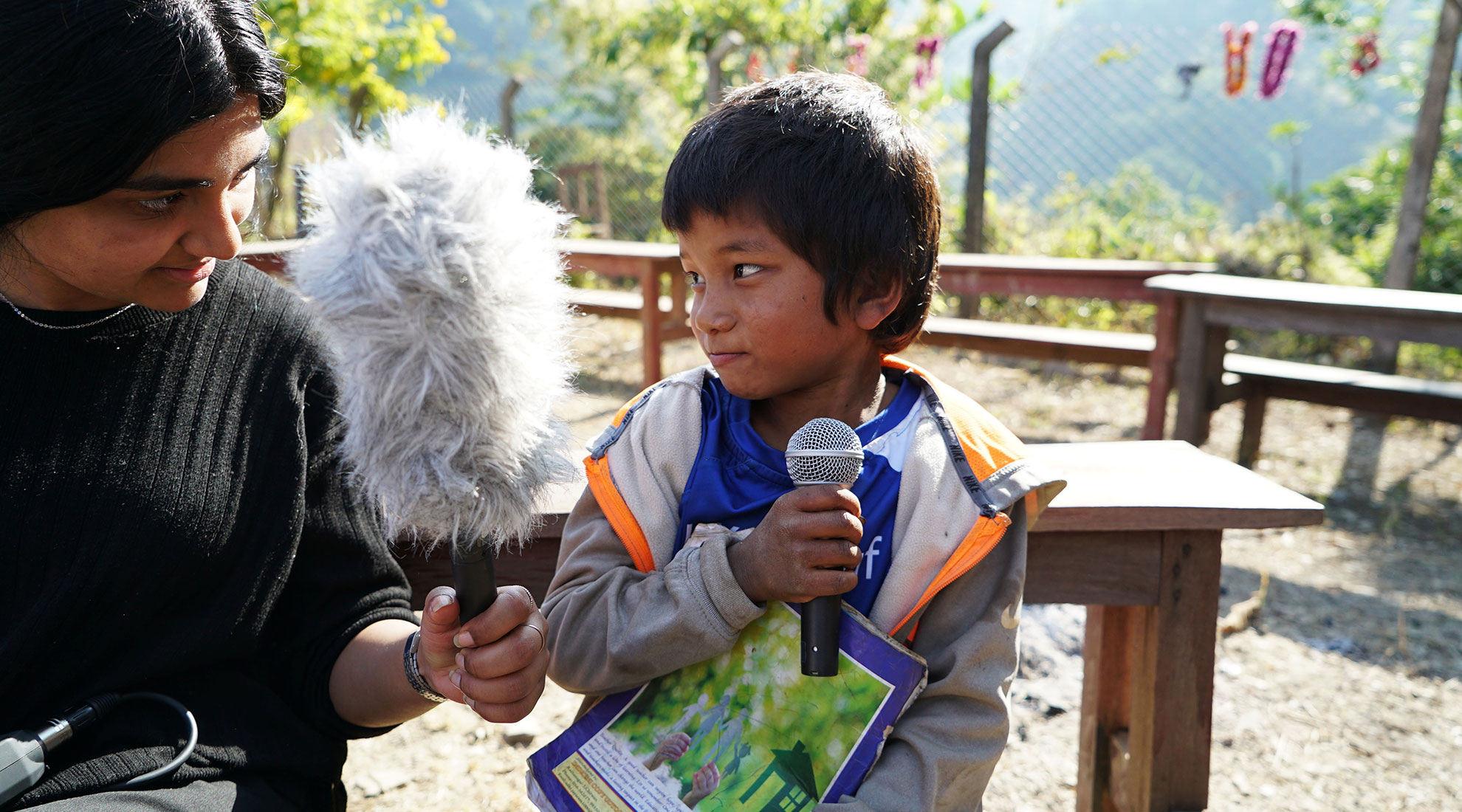 A journalist interviewing a young boy
